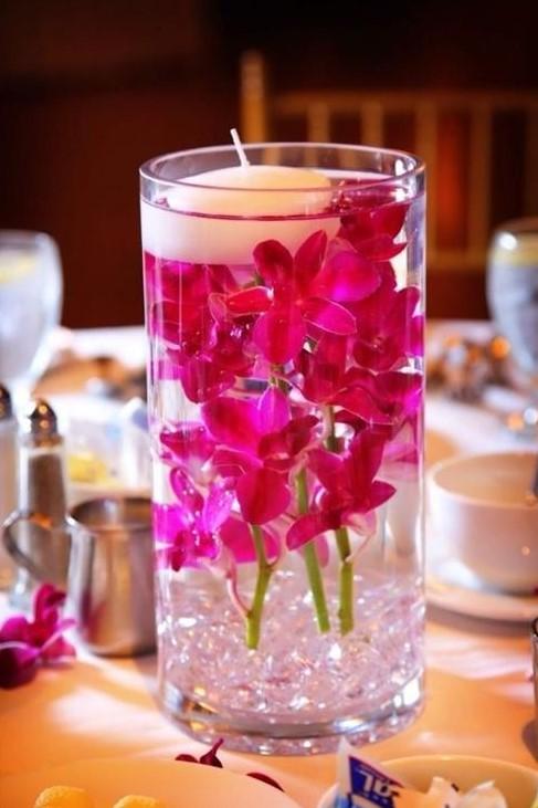 تزئین شمع با گل و آب